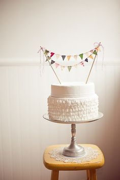 a ruffle-y cake served on a pretty cake stand