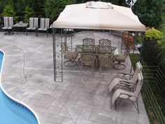 Stamped pattern adds dimension to this concrete pool deck.  Endless Concrete Design Zionsville, PA