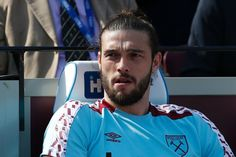 West Ham United's English striker Andy Carroll sits on the substitutes bench during the English Premier League football match between West Ham United and Swansea City at The London Stadium, in east London on April 8, 2017. / AFP PHOTO / Ian KINGTON / RESTRICTED TO EDITORIAL USE. No use with unauthorized audio, video, data, fixture lists, club/league logos or 'live' services. Online in-match use limited to 75 images, no video emulation. No use in betting, games or single club/league/player…