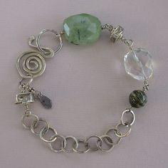 "Gemstone bracelet. Faceted nuggets of prehnite and quartz crystal join zebra jasper and sterling silver beads on this bracelet of handmade sterling silver chain. Handmade sterling silver clasp. 7 1/2"""