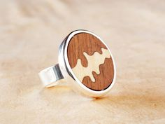Ring with Wood inlay and silver plated. Anillo de madera y plata.  http://www.cmgarte.com/en/rings/235-ring-with-natural-wood.html