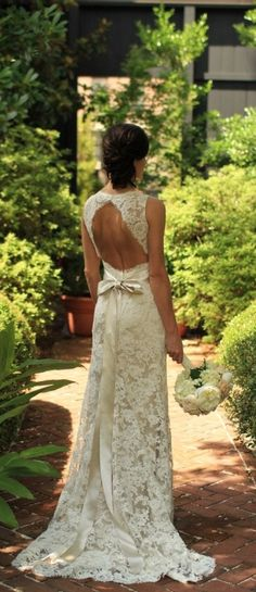 I'm not much of a lace girl, but this wedding dress is beautiful. I love the cutout in the back and satin bow.