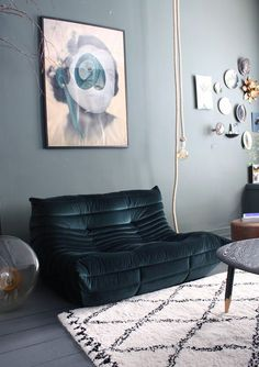 low teal sofa with blue wall / sfgirlbybay