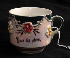 "German luster ware antique sentiment cup: ""Love the Giver."" I collect these charming little cups, also known as ""Friendship Cups."""