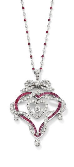 A ruby diamond heart pendant necklace  Designed as a calibre-cut ruby openwork heart entwined by a line of brilliant-cut diamonds suspending a central similarly cut diamond heart, to a diamond bow surmount, millegrain-set diamond drop highlights, and suspended on a spectacle-set ruby and diamond chain, length 41 cm, pendant length 6.2 cm. Edwardian or Edwardian style.\\