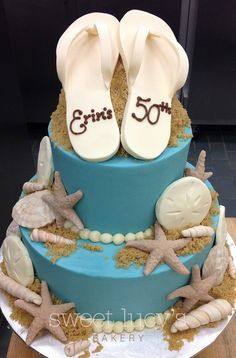 Beach themed cake with flip flops and sea shells