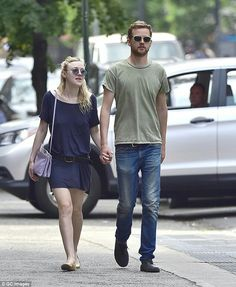 Low key: Dakota Fanning preferred comfort over glamour during a hand-in-hand stroll in NYC with boyfriend Jamie Strachan on Thursday