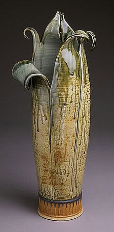 Thrown and altered. corn husk::earth tones,  pulled rim, vase shape Very cool vase.....CF
