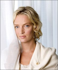 """""""Nothing coy"""" here: Uma Thurman is superhero G-Girl in My Super Ex-Girlfriend. The movie arrives Friday."""