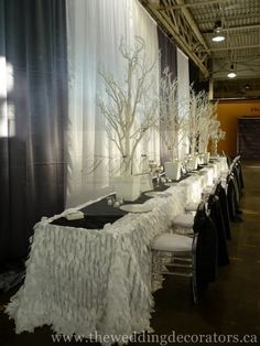 Imagine this as your head table with a white table cloth and skirt.  Imagine adding a lavender table runner down the length of the the table (In place of the black one here) that would be pretty.