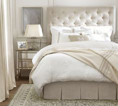 The tufted headboard and mirrored nightstand go nicely together.  Lorraine Tufted Bed, Full, Linen Natural, Pottery Barn