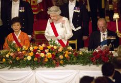 South Korea's President Park Geun-hye  listens as Britain's Queen Elizabeth II makes a speech a state banquet at Buckingham Palace on November 5, 2013 in London, England.