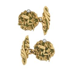 Pair of Art Nouveau Gold, Plique-à-Jour Enamel and Diamond Cufflinks The gold cufflinks of garland and floral design, applied with green plique-a-jour enamel, accented by 2 single-cut diamonds, circa 1900, approximately 4 dwts.