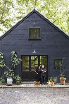 Modern Rustic Exterior: Michele Michael and Patrick Moore stand outside the barn on their Maine property.