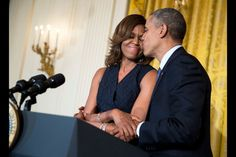 Pin for Later: The Obama Family's Best Snaps of the Year  President Obama kissed First Lady Michelle Obama when she spoke at an Affordable Care Act reception in May.