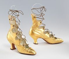 """ca. 1918 leather evening boots; Bray Bros.; American. Originally called """"Grecian boots"""", by 1913 they were called """"tango boots"""". The straps held the shoe securely to the foot when dancing and the metallic leather attracted attention to the movement of the feet."""