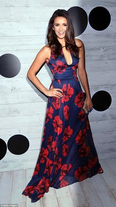 Floral fancy: The 26-year-old brunette utterly wowed in a blue and red flowery dress with ...