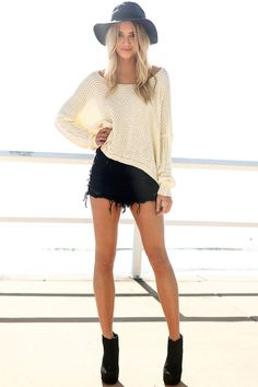 loose sweater paired with denim shorts & booties = perfect fall transitional outfit.