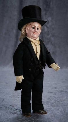Rare Bisque Character Portraying Older Gentleman with Superb Antique Costume ~~Comments: maker unknown, circa 1890. Value Points: very rare doll with outstanding detail of sculpting, fine antique gentleman's formal wear ensemble of couturier quality, including top hat.