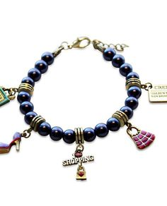Shopper Mom Charm Bracelet in Gold. The perfect gift for any mom that loves to shop. Give that special shopper mom a memorable gift with this colorful shopping themed charm bracelet.