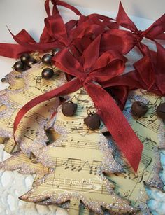 tree ornaments -sheet music on card stockwith ribbon and rusty jingle bells added