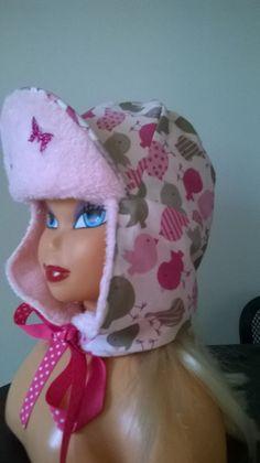 Il est souvent bien difficile, on le sait, de faire garder aux jeunes  enfants leurs bonnets - 10540281 a1798344992