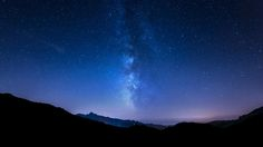 Milky Way in Tuscany - night sky panorama with stars and Milky way behind mountain