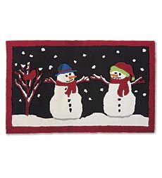 Add a splash of seasonal color and style anywhere in your home with this durable and machine washable Snowman Rug.