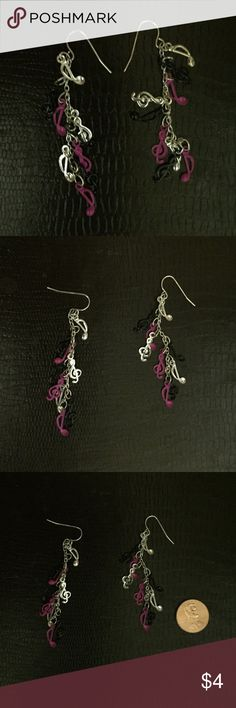 Music Theory pink, silver & black dangle earrings These fun and funky dangle earrings are perfect for any music teacher or music fanatic. They feature a cascade of notes and staff signs in pink, black and silver tones. These have been previously enjoyed and are now cleaned and polished and ready to dangle from a new pair of ears. Jewelry Earrings