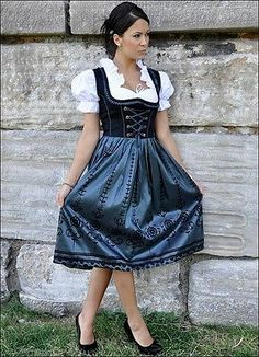 Inexpensive Dirndl Oktoberfest German Austrian Dress Sizes 6 - 22   eBay $39.90 (I am almost willing to spend the money just to see how nice they are.  I would use my own apron, because the ones represented here aren't very pretty...)