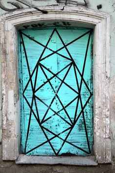 This Russian door is sporting a bright aqua color and fun geometric design.  doors of the world.  travel. Russia. Asia. Europe.