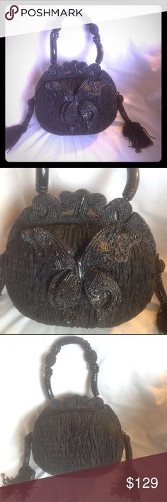 Mary Frances Butterfly handbag Breathtaking black butterfly design handbag. Beautiful beading magnetic closure, in almost new condition. Only used twice. Exotic decor on each side of bag with tassels n beads. Open to reasonable offers, please use the offer button. Thanks for stopping by Mary Frances Bags Mini Bags