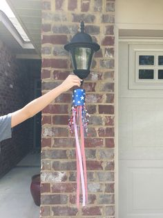 Patriotic or 4th of July decor handcrafted windsock for garage carriage lights.