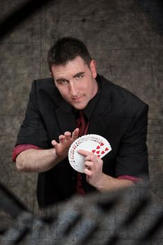 """J performs right in front of your eyes, mingling in a crowd or moving from table to table, group to group or person to person. Creating """"illusions of the impossible,"""" he performs highly sophisticated and entertaining sleight of hand, typically with cards and coins, frequently involving your guests in the action! No smoke, no mirrors, just awe inspiring close up entertainment. Sleight Of Hand, Close Up, Illusions, Crowd, Mirrors, Coins, Action, Entertainment, Smoke"""