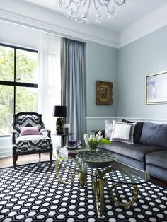 eclectic living room by Greg Natale - love the brass ram's head based coffee table - more at houzz.com