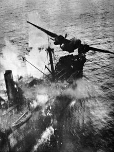 World War II - U.S. A-20 Havoc of the 89th Squadron, 3rd Attack Group, at the moment it clears a Japanese merchant ship following a successful skip bombing attack. Wewak, New Guinea, March 1944