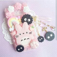 The final photo for our pink collection! This beautiful case is from @pasteldreamzshop with some cabochons from @ririsweetdeco! I love the pink totoro centerpiece on it and the cute sootballs woth pink whip! #pasteldreamzshop #pinkdecoden #hayaomiyazaki #hayaomiyazakidecoden #mntdecoden #spiritedawaydecoden #decoden #decodenphonecase #phonecase by kawaiidenwa