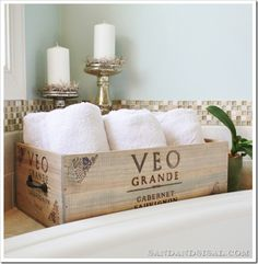 GREAT tutorial (with pictures and everything) on how to turn in that rustic wine crate into a durable and functional storage box (with handles.)  Great for towels, blankets, and even Wine!  Wine Crate Storage