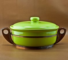 California Pottery Bauer Monterey Moderne Kitchenware, Vintage 1-1/2 Qt. Casserole Dish in Copper & Wood Frame. Classic Early California Pottery, Vintage c.1949 - 1959 Bauer Pottery Monterey Moderne Kitchenware. Tracy Irwin's Contemporary Design with Jim Johnson's Solid Gloss Chartreuse Glaze. 1-1/2 Quart Lidded Casserole Dish in a Copper Frame with Wood Handled Holder. Bauer Model No.# 455.  8-1/2 in. Wide by 3-1/2 in. Tall. Debossed Manufactures Mark on Base: BAUER