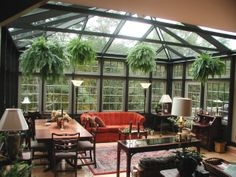 Beautiful Conservatory. I think they work best when there are some mature trees nearby to give the room shade at least part of the day.