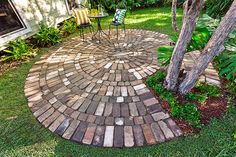 How to make a circular paved area: Give your garden curves with a circle of rustic brick paving, complete with a delightful centre pattern pressed into the mortar