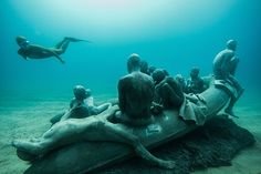The Raft of Lampedusa in situ. Artist Jason deCaires Taylor's Museo Atlántico, off Lanzarote, Islas Canarias, Spain, is peopled with concrete casts of refugees and people taking selfies.  #Spain #News