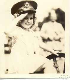 A very young Shirley Temple entertaining the troops Stateside