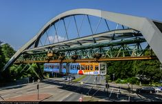 The Wuppertal suspension railway is one of the safest modes of transport in the world. The route from Vohwinkel to Oberbarmen is 13.3 km long. The train in the picture is crossing a main road near the station Ohligsmühle.