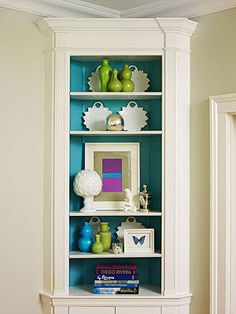 """Colorful Cabinets To highlight a few of her favorite objects, Eileen painted the inside of a corner cabinet in the formal dining area the same shade as the living room. """"I like to repeat a color several times in an interior—it's an easy way to tie all the rooms together."""""""