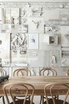 Incredible!  This would be so easy/inexpensive to DIY as a personalized collage wall with old stuff laying around the house or from garage sales.