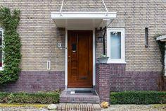 Jaren30woningen.nl | Mooi jaren 30 voordeur met luifel