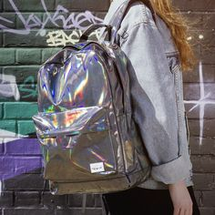 How exactly did the Hologram Backpack come to be Was it retrieved from an oil slick Blasted out of a shimmering supernova Perhaps it…