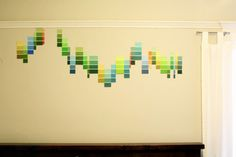 """""""My project this week was to take over my wall with a wavy arrangement of paint samples. I just cut various color swatches to alternating sizes and created the design as I went."""" This project can easily be modified on the fly in both design and color—try different arrangements as your monthly, weekly, or daily spirit determines."""