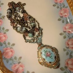 This is a magnificent antique blue guilloche enamel locket from the early part of the last century. It has been hand painted with a lovely pink…